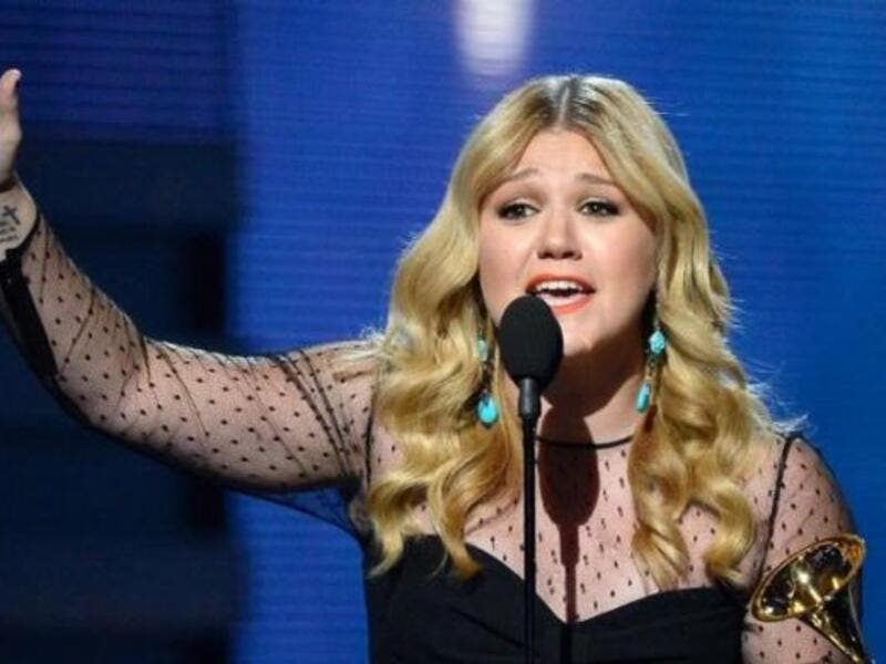 Kelly Clarkson reacts on stage as winning the Best Pop Vocal Album during the 55th Grammy Awards in Los Angeles. (AFP/File)