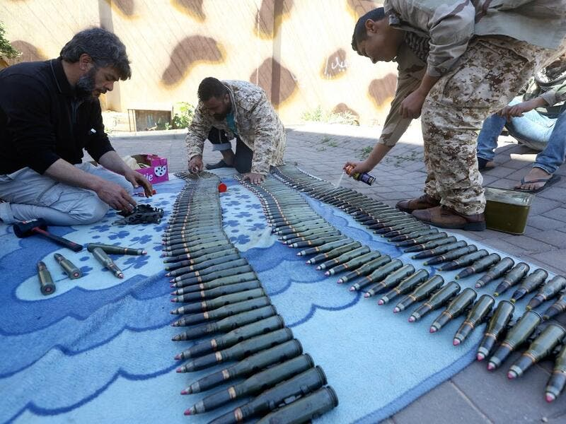 Fighters from a Misrata armed group loyal to the internationally recognised Libyan GNA prepare their ammunition before heading to the frontline as battles against Forces of Libyan strongman Khalifa Haftar continue on the outskirts of the capital Tripoli on April 9, 2019. Mahmud TURKIA / AFP