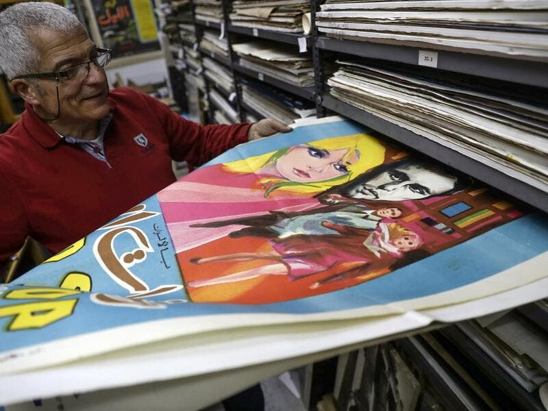 Abboudi Abu Jawdeh shows part of his vintage cinema poster collection at his office in the Lebanese capital Beirut  JOSEPH EID / AFP