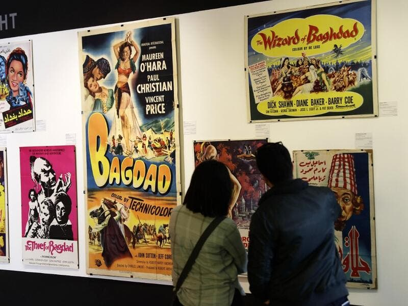 In a Beirut cultural centre, Lebanese film buff Abboudi Abu Jawdeh is exhibiting vintage film posters from his collection that show off a lost art, but also offer insight into decades of Western cliches of the Arab world. JOSEPH EID / AFP