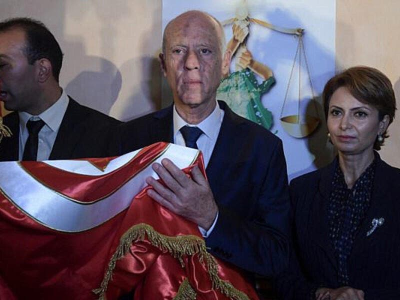 Kais Saied and his wife Ichraf Chebil  /Fethi Belaid/AFP