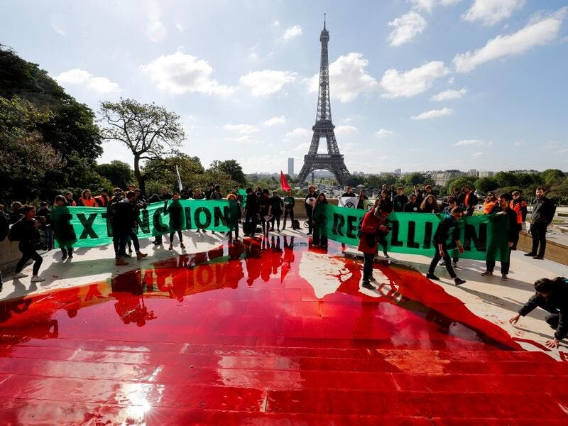 Extinction Rebellion (XR) is an international movement that uses non-violent civil disobedience to achieve radical change in order to minimise the risk of human extinction and ecological collapse.  FRANCOIS GUILLOT / AFP