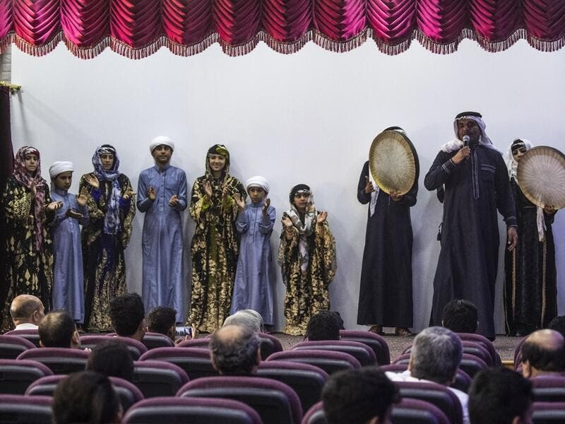 Members of a traditional music and dance group perform at the first cultural centre to open since ISIS ended  its rule in the eastern Syrian city of Raqa on May 1, 2019. DELIL SOULEIMAN / AFP