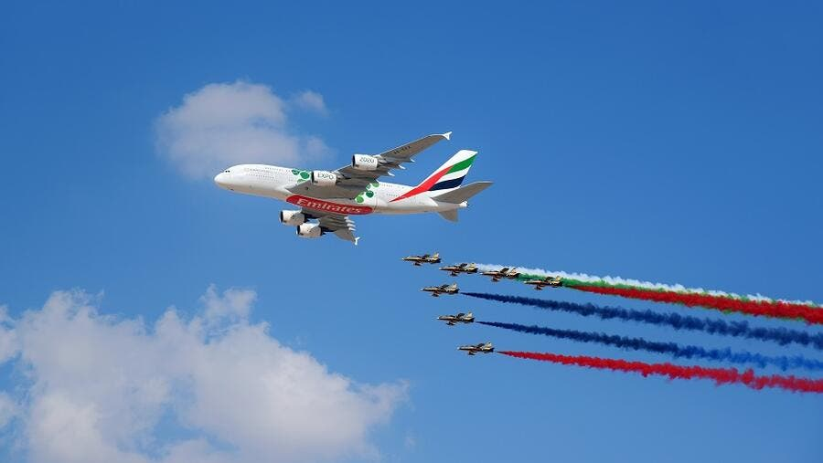 The Emirates A380 marks the opening of the Dubai Airshow with unprecedented flypast accompanied by 26 Military and Air Display Aircraft