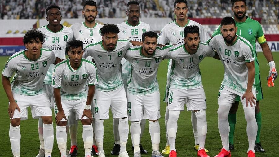 Ahli's starting eleven pose for a group picture ahead of the AFC Champions League group A match against al-Wahda FC at al-Nahyan Stadium in Abu Dhabi on February 10, 2020.