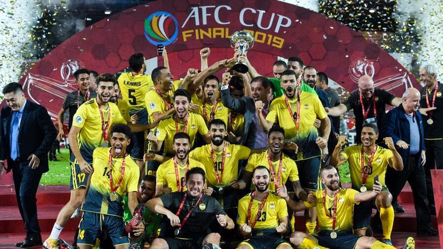 Al Ahed's players and coaching staff celebrate with the trophy on Nov 4, 2019.