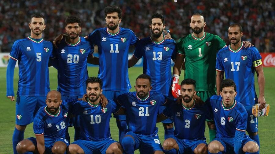 Kuwait's starting eleven pose for a group picture during the World Cup Qatar 2022 Group B qualification football match against Jordan at the Amman International stadium on Oct 10, 2019