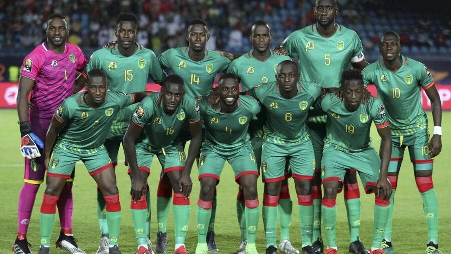Mauritania's players pose for a group picture ahead of their 2019 AFCON match against Mali at the Suez Stadium in Suez on June 24, 2019