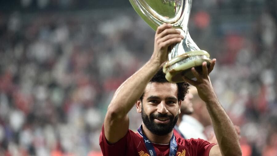 Liverpool's Mohamed Salah poses with the UEFA Super Cup 2019 Trophy