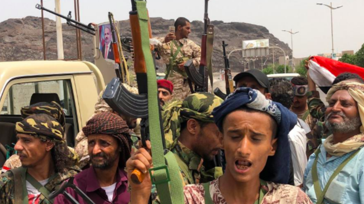 Yemeni supporters of the southern separatist movement pose for a picture in Khor Maksar, in the Yemeni southern port city of Aden on 10 August, 2019.