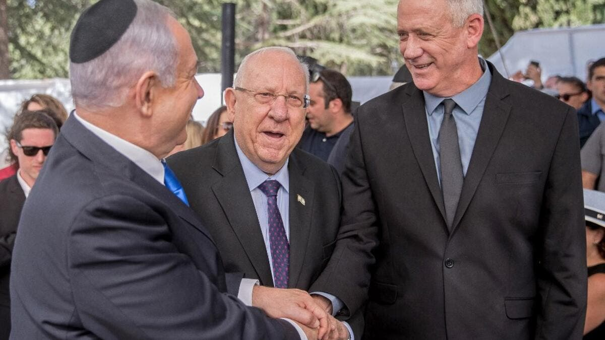 Israeli Prime Minister Benjamin Netanyahu (L), President Reuven Rivlin (C) and Benny Gantz, leader of Blue and White party (AFP)