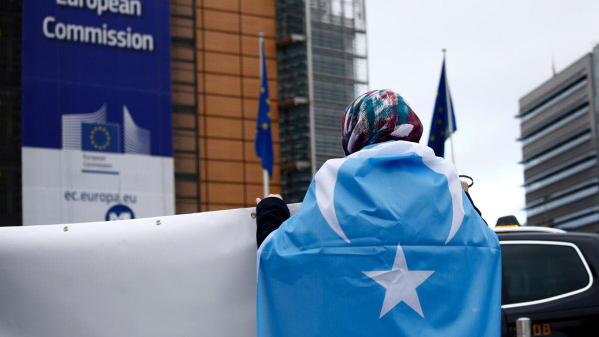 Activists protest the treatment of Uyghur Muslims by Chinese authorities in Xinjiang province at a protest outside the headquarters of the European Union. (Shutterstock/ File Photo)