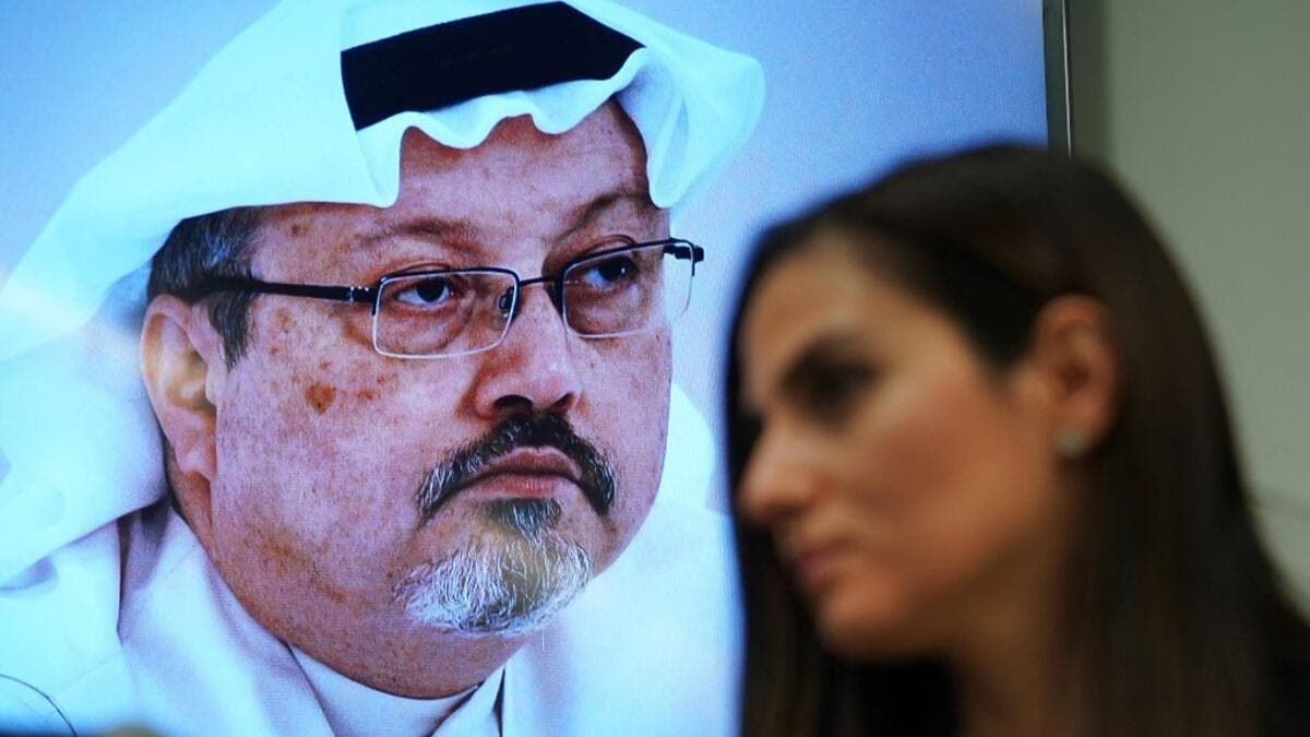 "In this file photo Sherine Tadros, head of New York (UN) Office of Amnesty International, speaks during a news conference at the United Nations on October 18, 2018 next to a photo of Jamal Khashoggi. A US intelligence report on the murder of journalist Jamal Khashoggi in the Saudi consulate in Istanbul will be out ""soon,"" the White House said on February 24, 2021. Press Secretary Jen Psaki said that President Joe Biden was also ""soon"" due to speak with Saudi Arabia's King Salman.  TIMOTHY A. CLARY / AFP"
