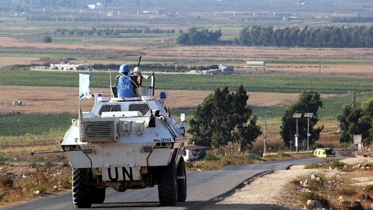 UN vehicles monitor the blue line