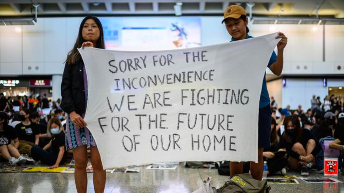Students stage an airport sit-in, before new restrictions in Hong Kong /AFP