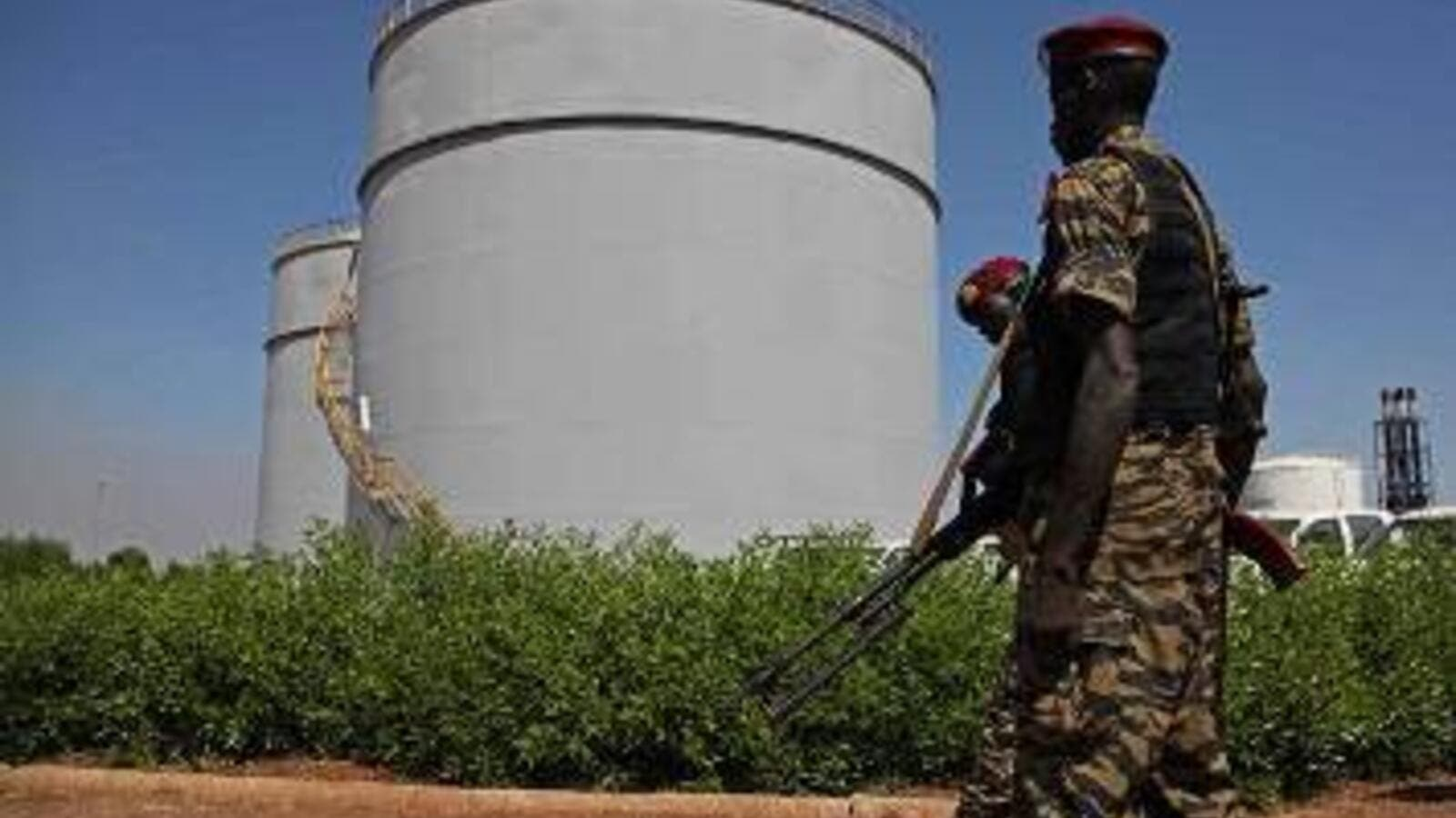 South Sudanese soldiers guard an oil refining facility.
