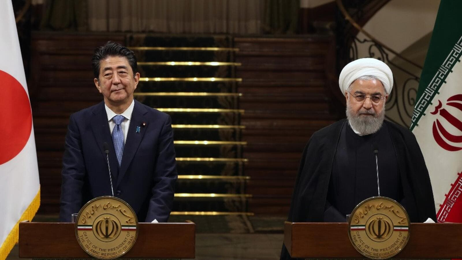 Iranian President Hassan Rouhani (R) and Japanese Prime Minister Shinzo Abe, give a joint press conference at the Saadabad Palace in the Iranian capital Tehran on June 12, 2019. (AFP/ File)