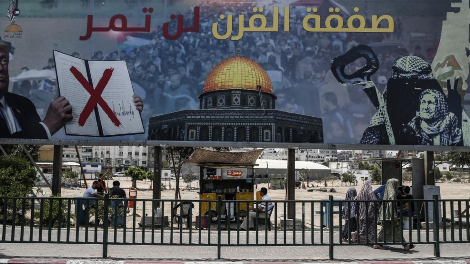 "A picture taken on June 16, 2019, shows a poster in Gaza City denouncing the US Middle East peace plan dubbed the ""deal of the century"". Arabic writing on poster reads ""The deal of the century will not pass"".  (MAHMUD HAMS / AFP)"