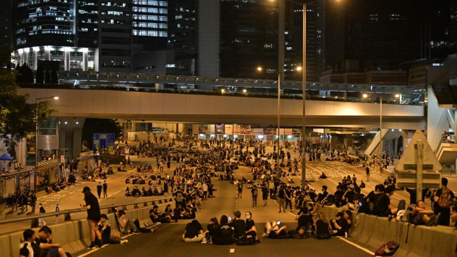 Protesters rest on a road as they rally against a controversial extradition bill in Hong Kong early on June 17, 2019. (AFP/ File Photo)