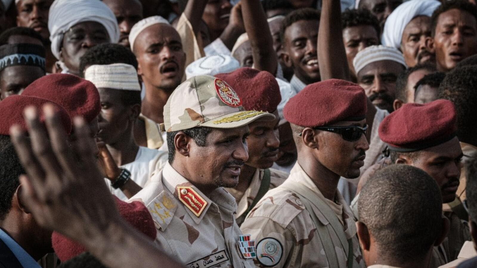 Mohamed Hamdan Dagalo, known as Himediti, deputy head of Sudan's ruling Transitional Military Council (TMC) and commander of the Rapid Support Forces (RSF) paramilitaries, arrives to give a speech during a rally in the village of Abraq, about 60 kilometers northwest of Khartoum, on June 22, 2019. (Yasuyoshi CHIBA / AFP)