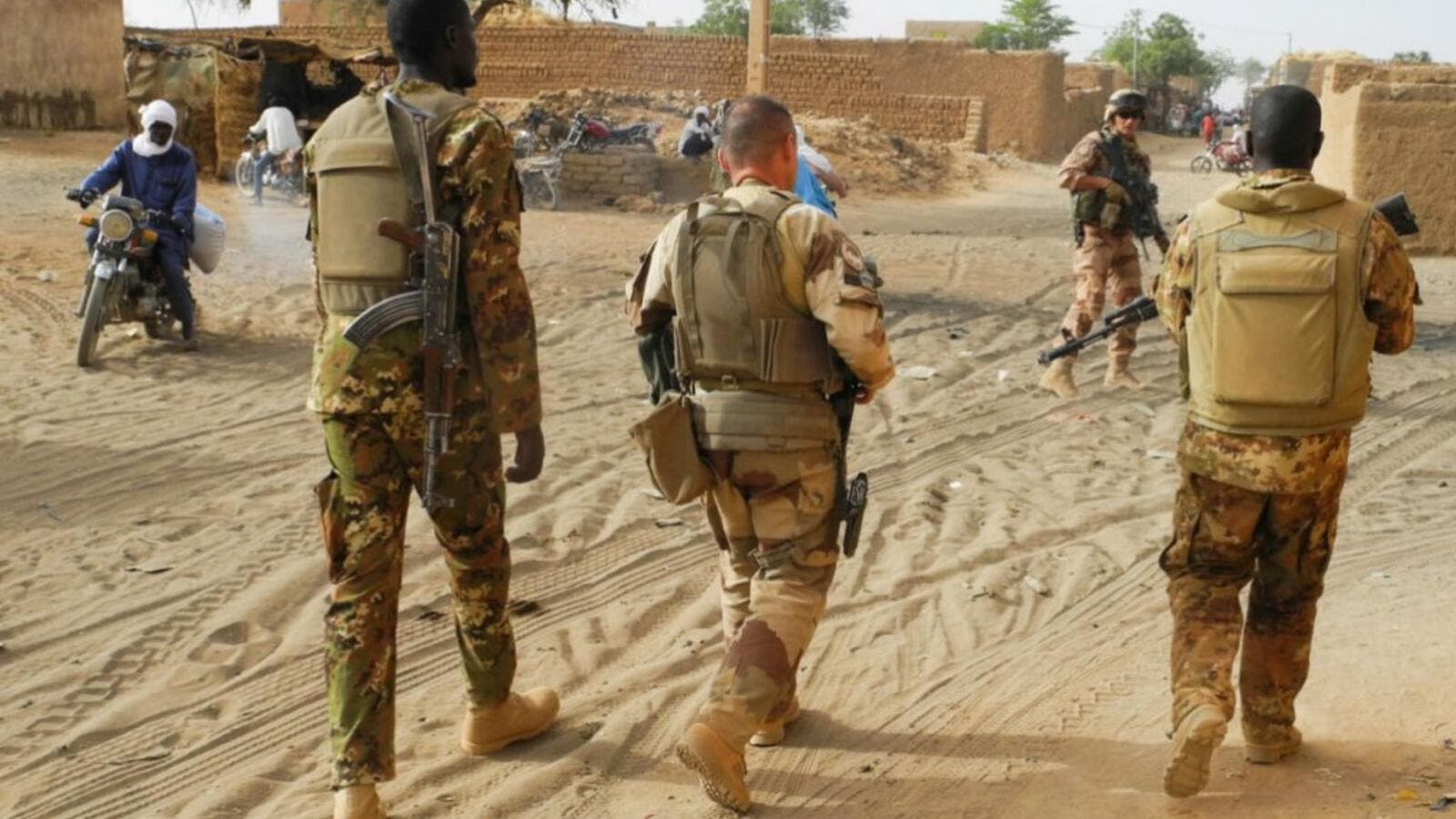 Soldiers from the Malian army patrol with soldiers from France's Barkhane Force in a street of Menaka. (AFP/ File Photo)
