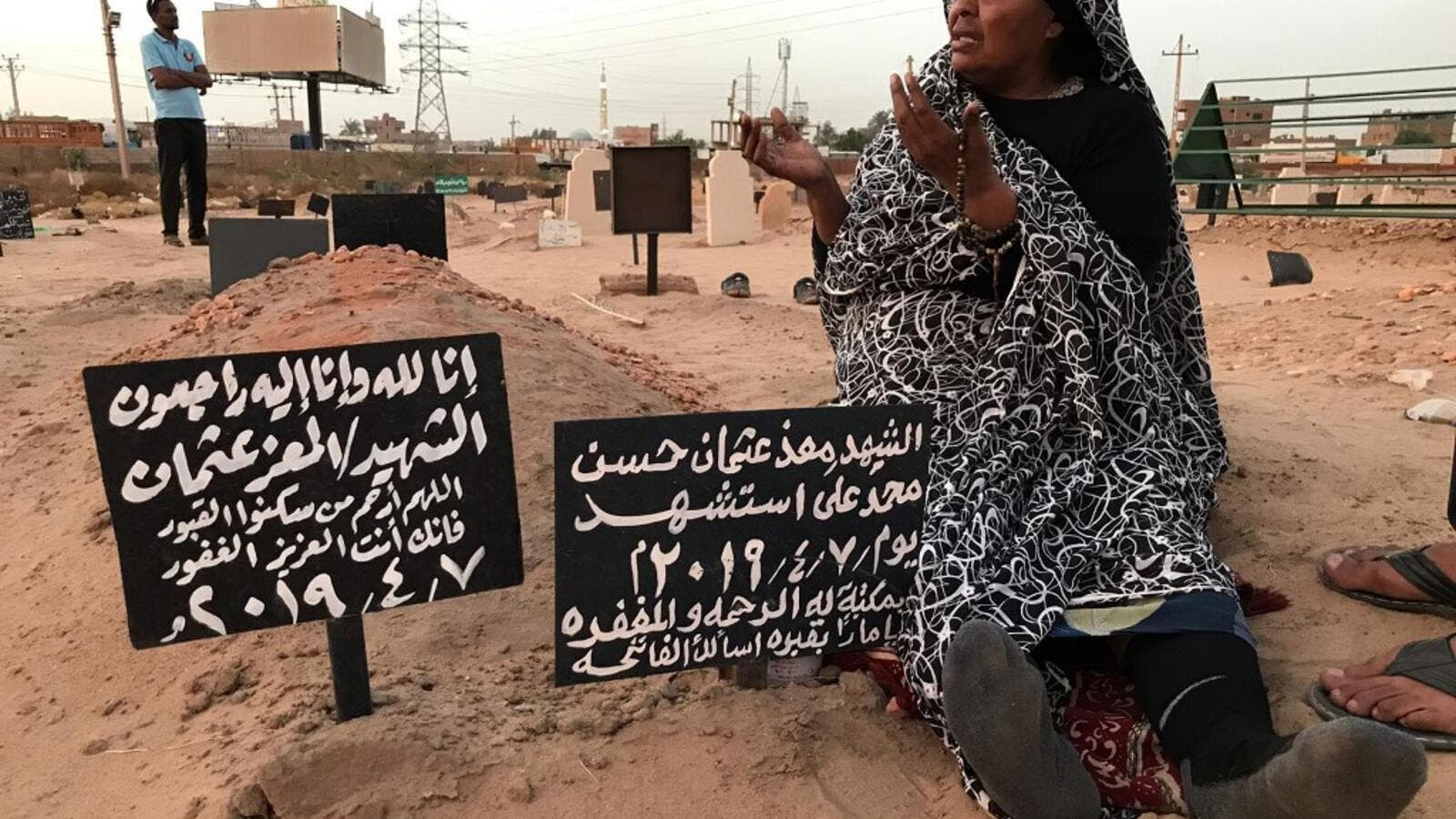 Khadom, the mother of Al-Moez visits the tomb of her son, killed when a bullet pierced the window of his workplace and lodged itself in his heart during an anti-government demonstration in the Sudanese capital Khartoum in April, on July 9, 2019. (AFP/ File Photo)