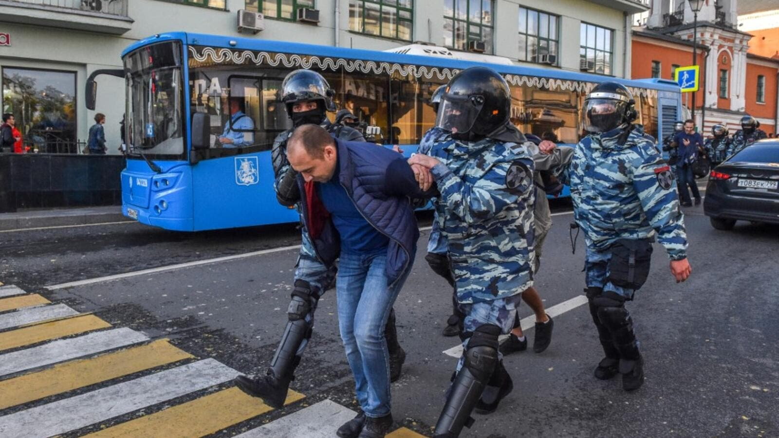 Servicemen of the Russian special police forces detain a man after a rally urging fair elections in central Moscow on August 10, 2019.  (AFP/ File Photo)