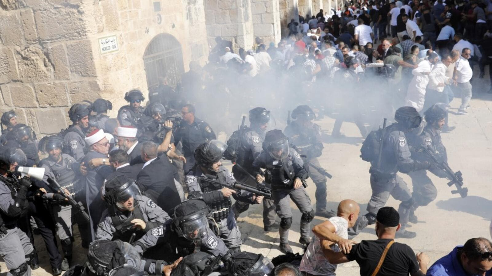 Israeli security forces fire sound grenades inside the Al-Aqsa Mosque compound in the Old City of Jerusalem on August 11, 2019, as clashes broke out during the overlapping Jewish and Muslim holidays of Eid al-Adha and the Tisha B'av holdiay. (AFP)