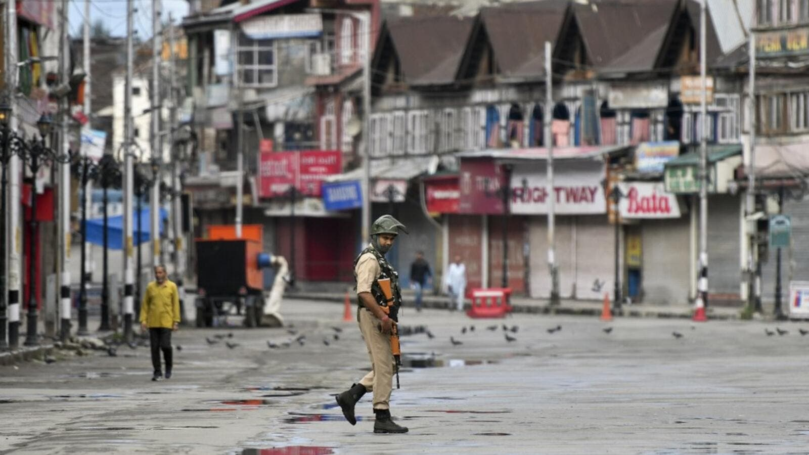 A security personnel patrols on a deserted road of the Lal Chowk area in Srinagar on August 19, 2019. (AFP/ File Photo)
