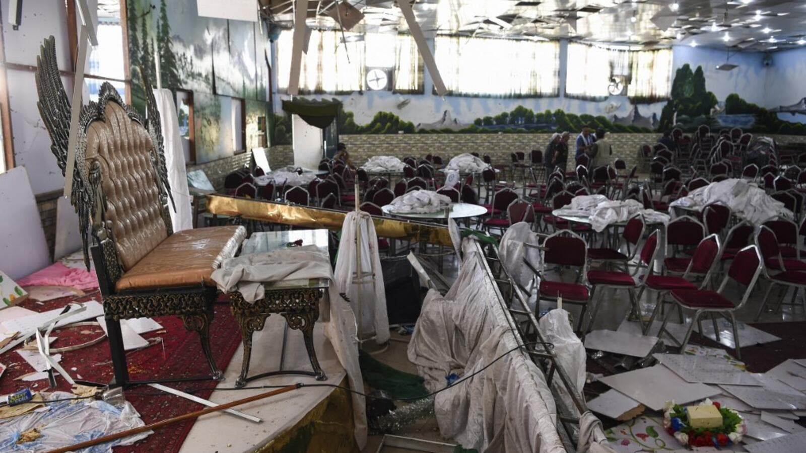Afghan men investigate in a wedding hall after a deadly bomb blast in Kabul. (AFP/ File Photo)