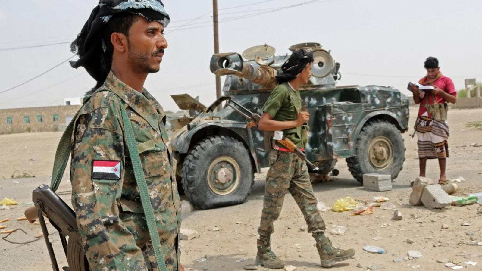 Fighters with the UAE-trained Security Belt Forces loyal to the pro-independence Southern Transitional Council (STC), gather near the south-central coastal city of Zinjibar in south-central Yemen, in the Abyan Governorate, on August 21, 2019. (AFP)
