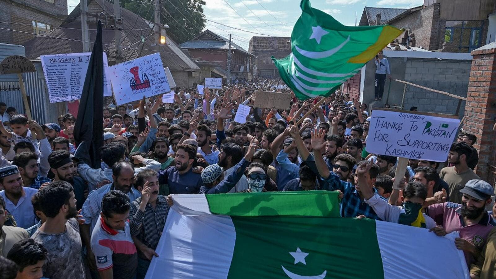 Kashmiri Muslims shout anti-Indian slogans during a protest at Anchar Soura locality of Srinagar on August 23, 2019. (AFP)