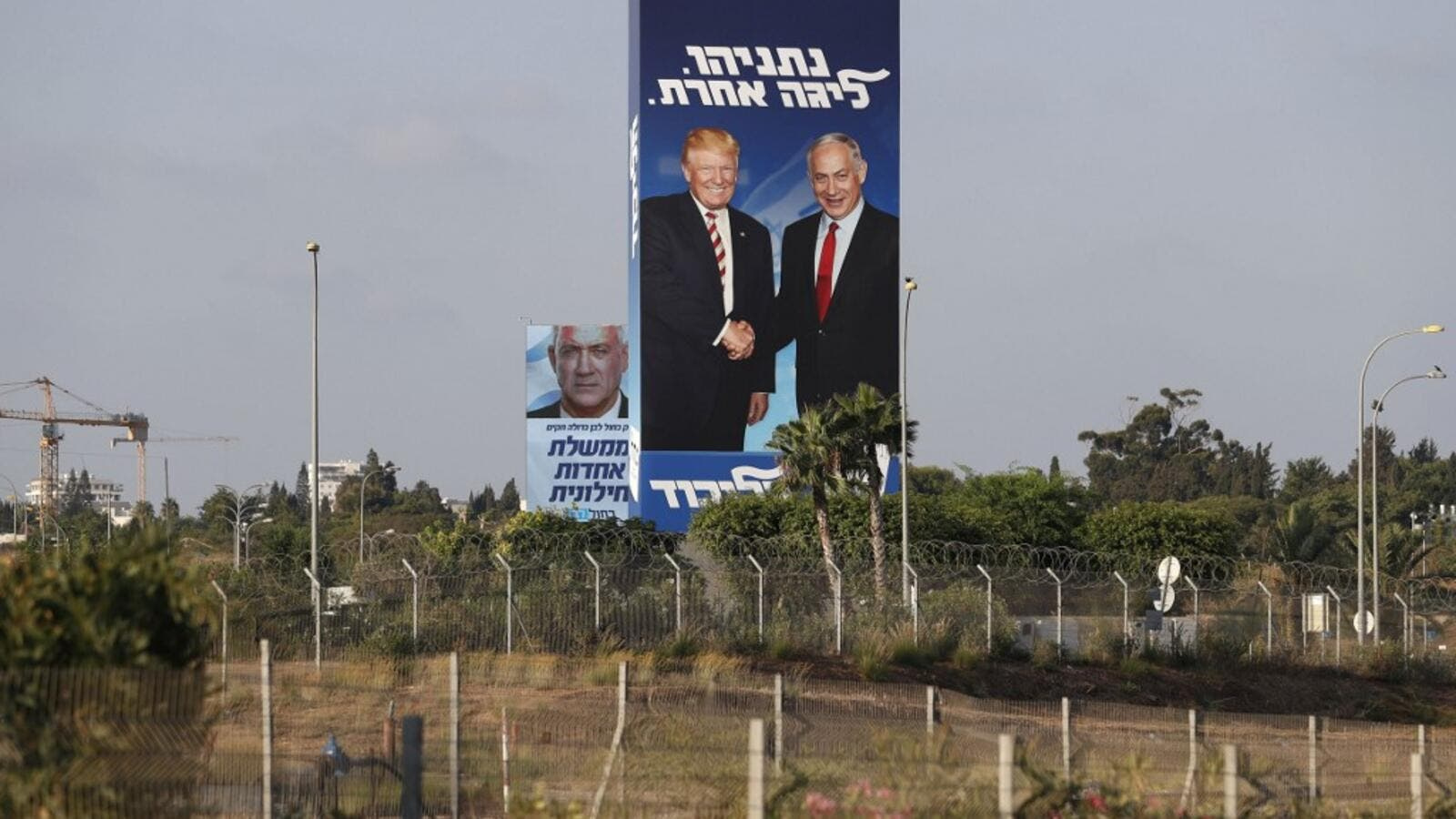 This picture taken on September 9, 2019 shows Israeli election billboards in the Israeli coastal city of Tel Aviv (R to L) for the Likud party showing US President Donald Trump shaking hands with Likud chairman and Prime Minister Benjamin Netanyahu  (AFP)