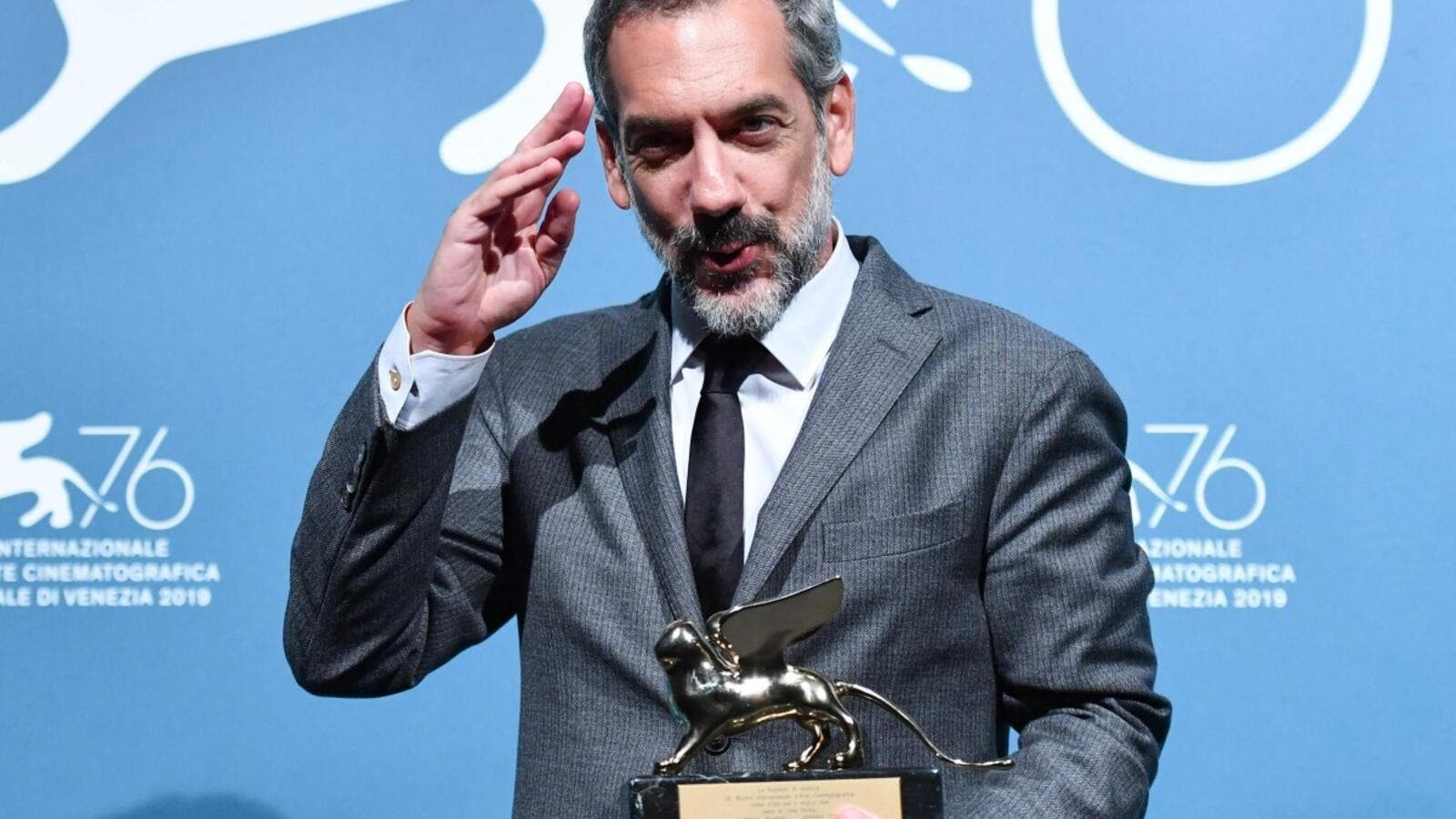 US director Todd Phillips holds the Golden Lion award for best film he won for Joker at the Venice International Film Festival this month. ( AFP)