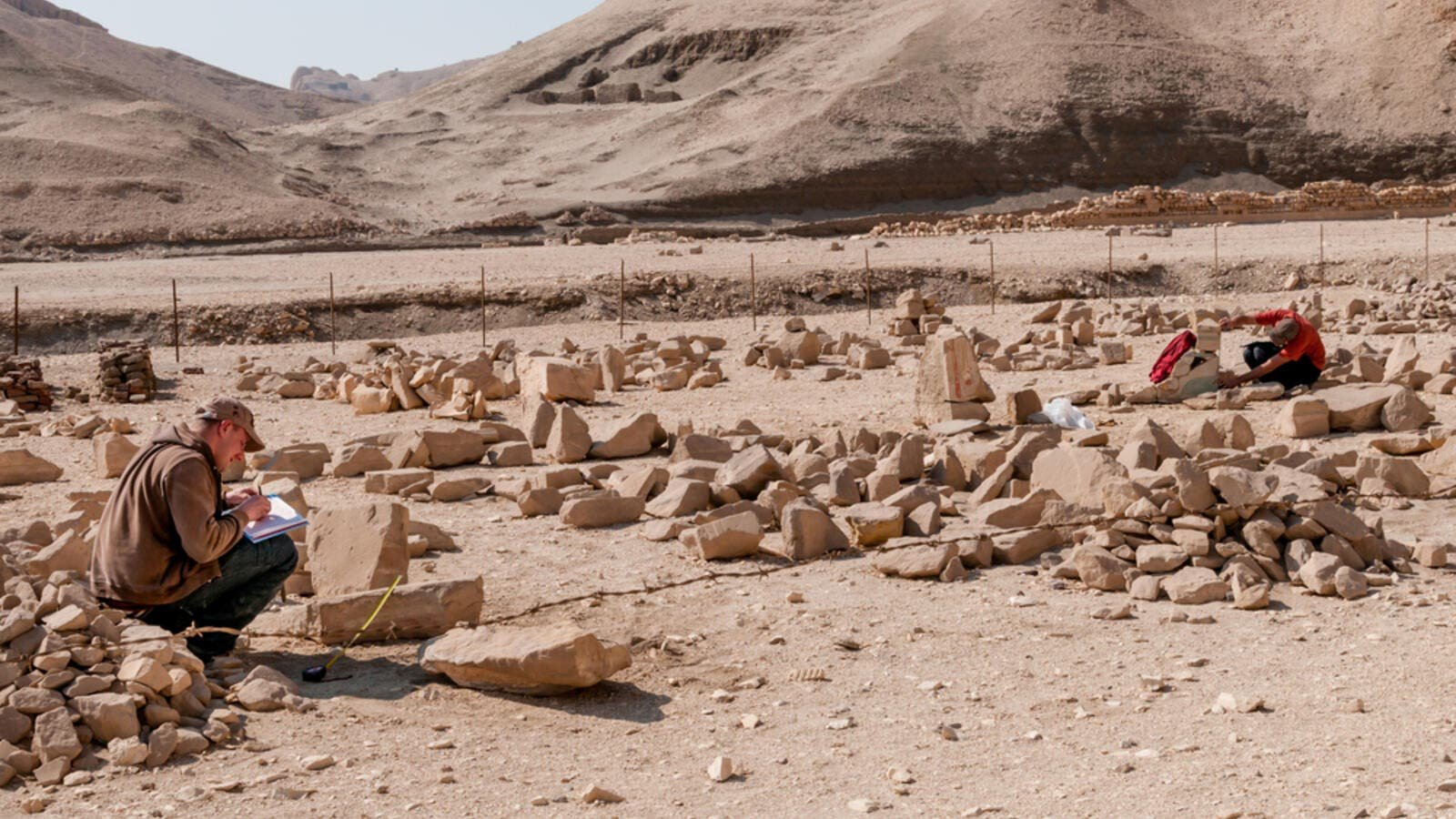 Archaeologists working near the Mortuary Temple of Queen Hatshepsut, located on the west bank of the Nile near the Valley of the Kings in Egypt. (Shutterstock/ File Photo)