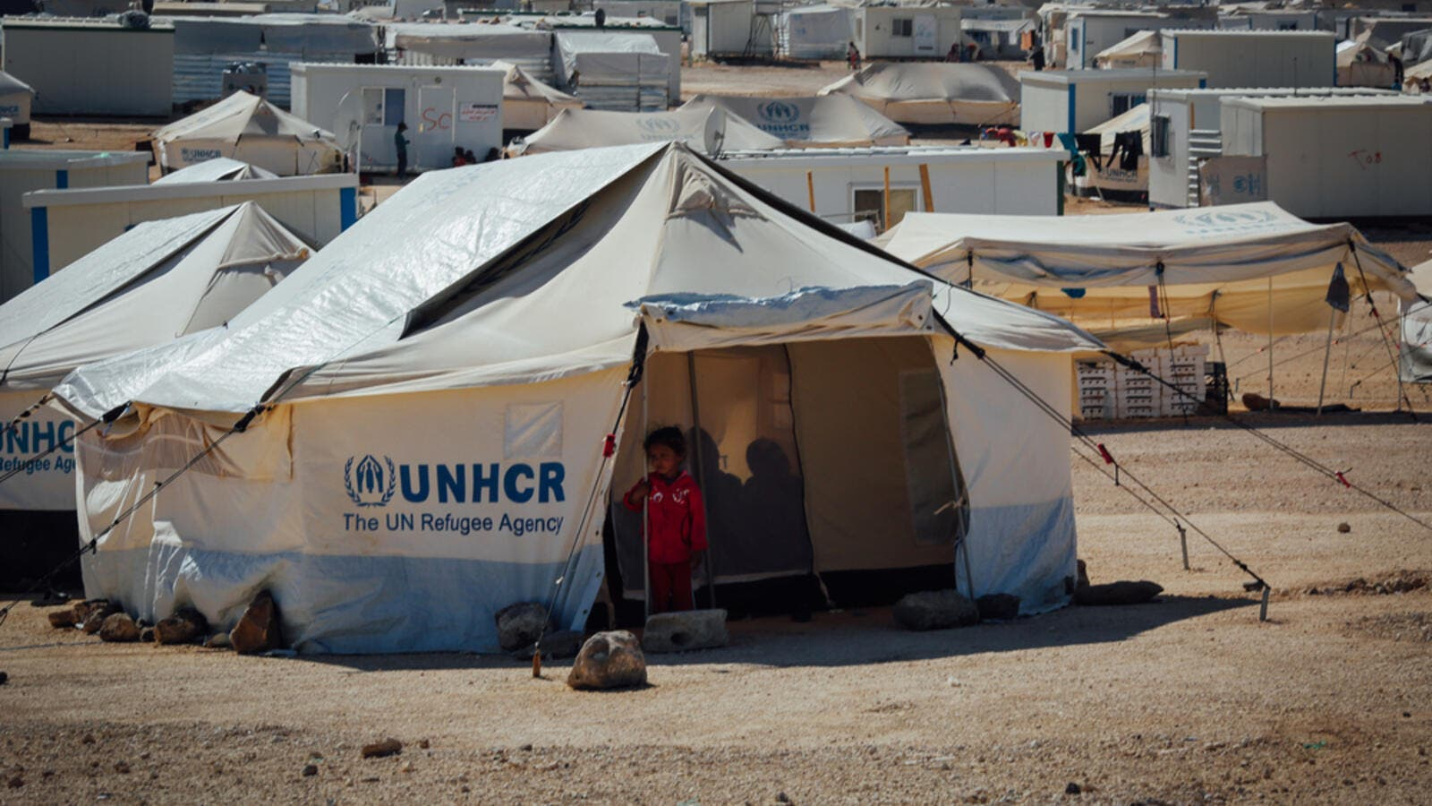 Syrian child standing outside her tent at the Zaatari Refugee camp in Mafraq, jordan. (Shutterstock/ File Photo)