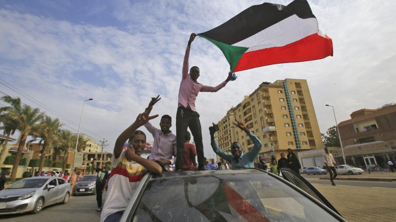 Sudanese protesters wave their national flag during a demonstration called for by the Sudanese Professionals Association (SPA) to denounce the July 29 Al-Obeid killings, in the capital Khartoum on August 1, 2019. (AFP/ File Photo)
