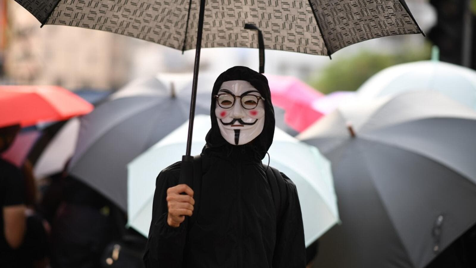 Hong Kong protesters arrested for defying a new face mask ban appeared in court on October 7 following a violent weekend of unrest which saw bloody clashes with police and widespread vandalism that crippled the city's train network. Mohd RASFAN / AFP