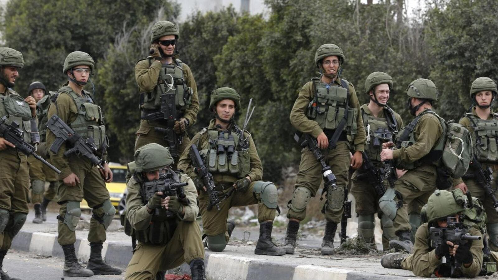 Israeli security forces are seen in the West Bank on 22 December 2017 [JAAFAR ASHTIYEH/AFP/Getty Images]