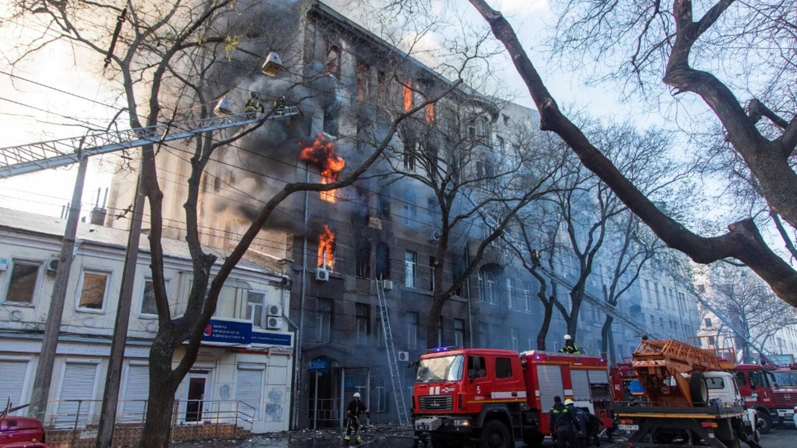 Firefighters extinguish a fire inside a college building in central Odessa on December 4, 2019. Ukrainian President Volodymyr Zelensky warned on December 5, 2019 that a deadly fire in the southern port city of Odessa could claim more victims, saying 14 people were still missing. Oleksandr GIMANOV / AFP