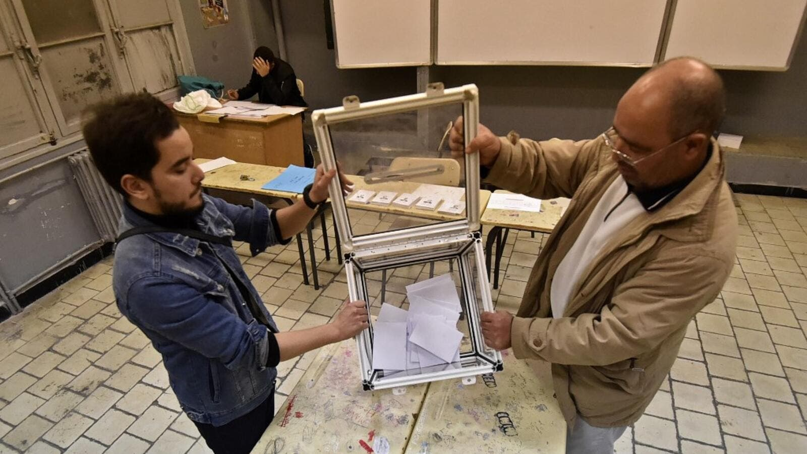 Election officials count ballot papers of the presidential election in the capital Algiers on December 12, 2019. Algeria held a tense presidential election meant to bring stability after a year of turmoil, but voting was marred as protesters stormed polling stations and staged mass rallies in the capital. RYAD KRAMDI / AFP