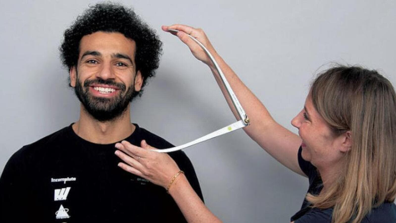Egypt's Mohamed Salah in London taking several measurements for his wax sculpture. Madame Tussauds