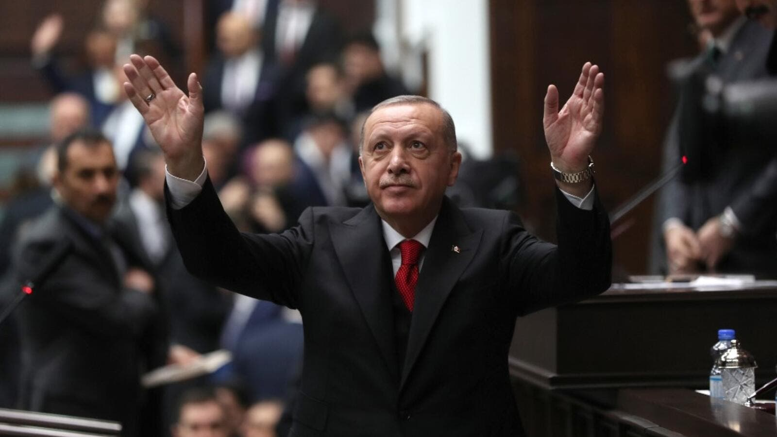President of Turkey and leader of Justice and Development (AK) Party Recep Tayyip Erdogan waves as he attends the party's group meeting at Grand National Assembly of Turkey in Ankara, on February 12, 2020. Adem ALTAN / AFP