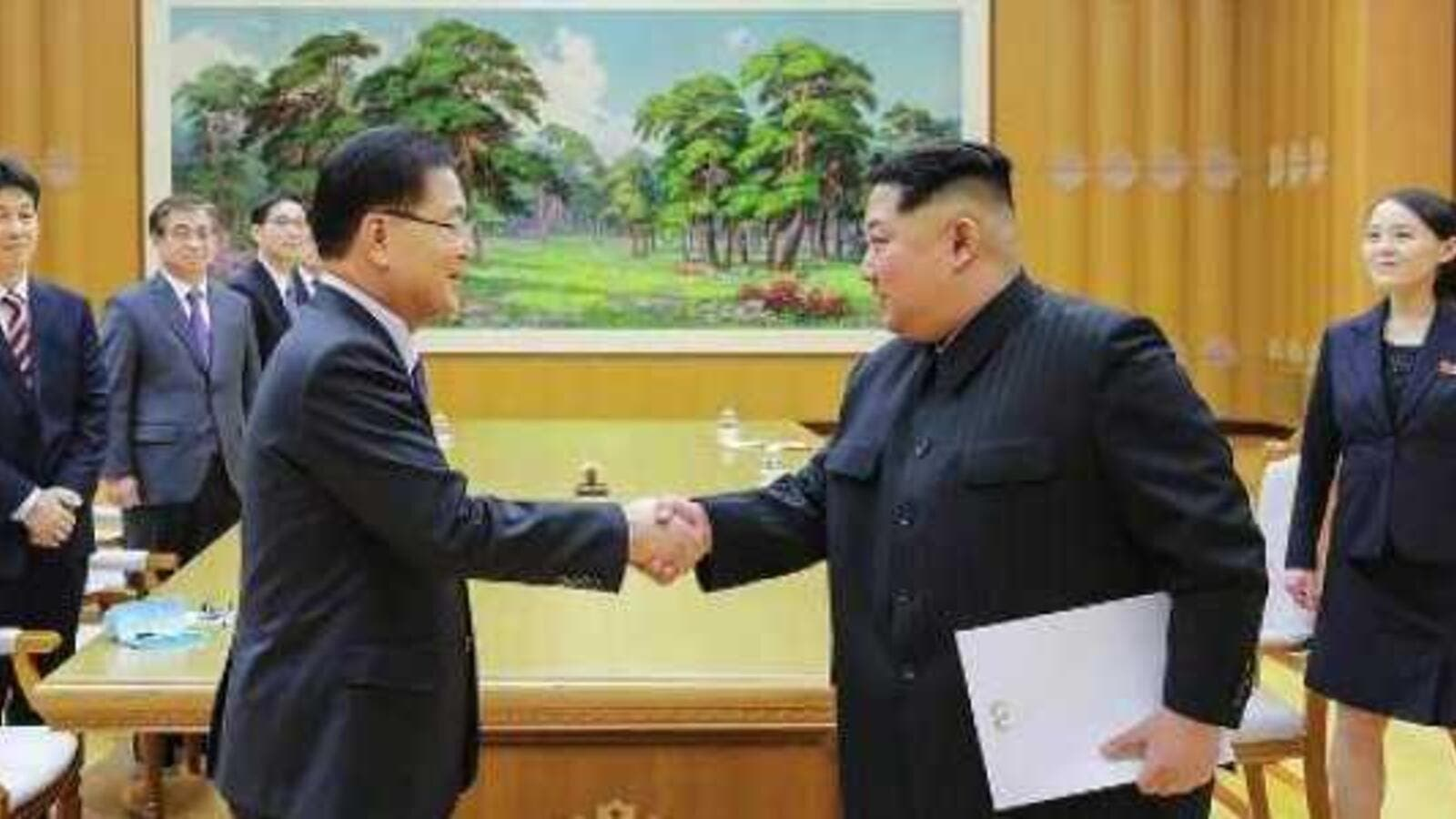 North Korean leader Kim Jong Un shaking hands with South Korean chief delegator Chung Eui-yong (AFP/File Photo)