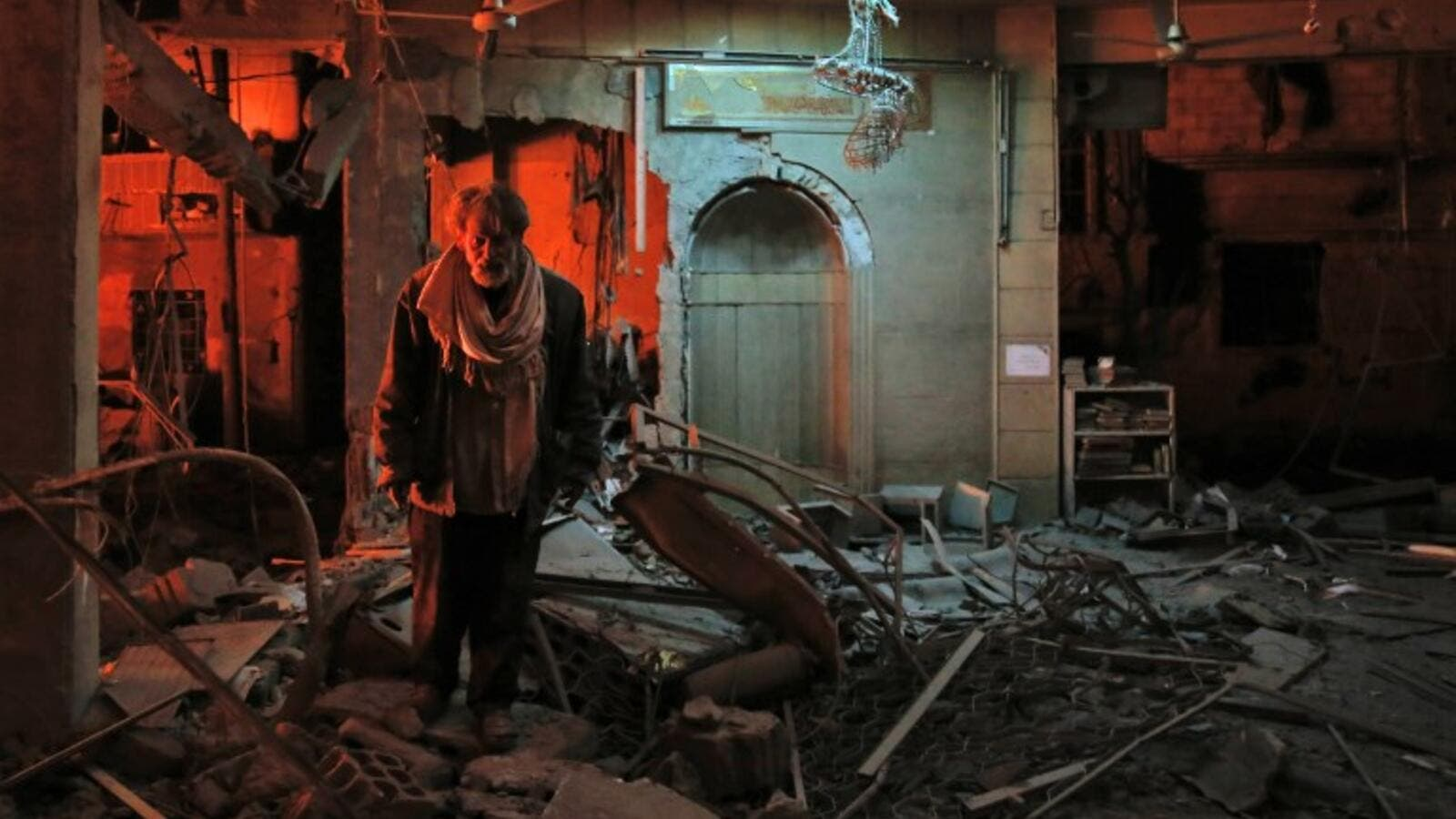 A man walks inside a mosque after an air strike in Douma, Eastern Ghouta, on Mar.19, 2018. The regime did not completely release the pressure on Douma however, the latest strikes killing at least 13 people overnight, the Syrian Observatory for Human Rights said. (HASAN MOHAMED / AFP)