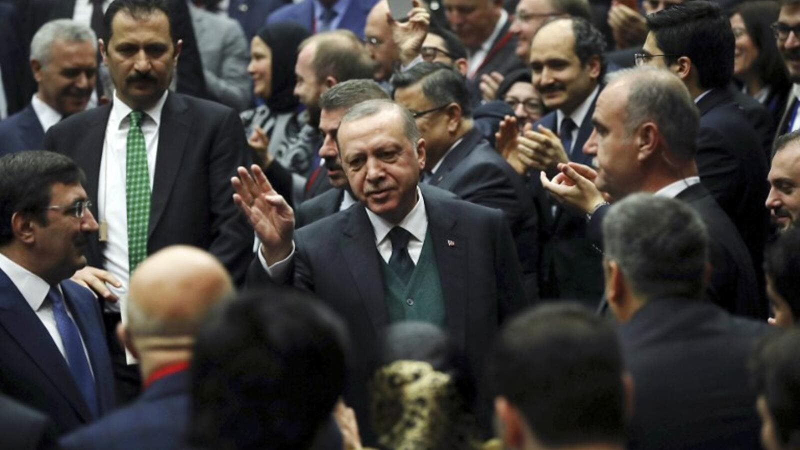 Turkish President Recep Tayyip Erdogan (C) greets the crowd during Turkey's ruling Justice and Development (AK) Party's provincial chairmen meeting at the party headquarters in Ankara on Mar. 30, 2018. 