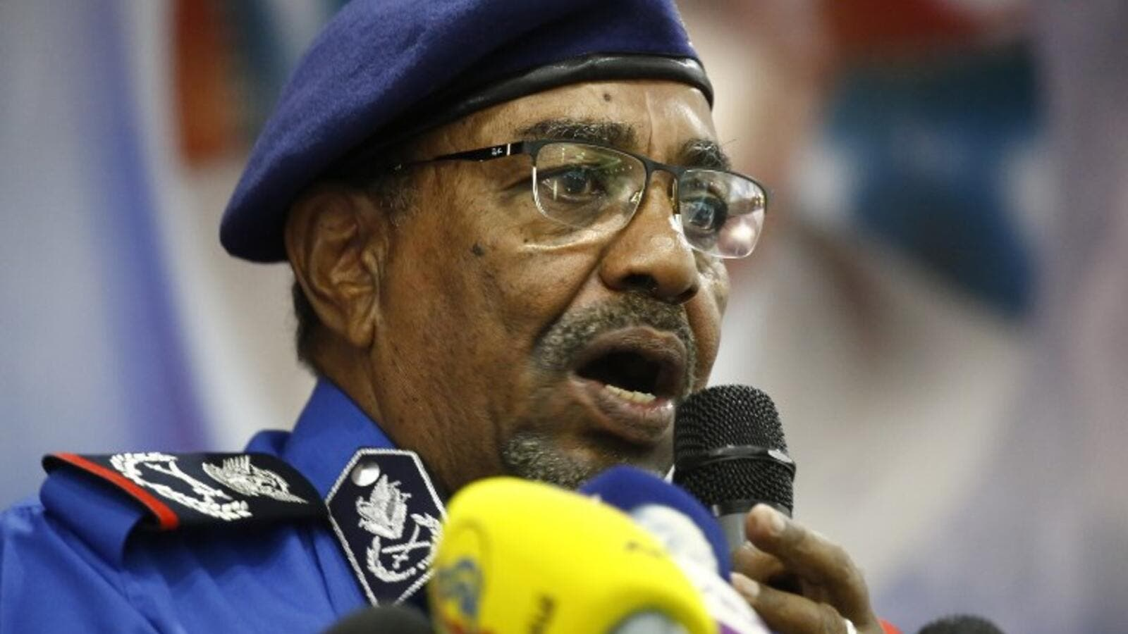 "Sudanese President Omar al-Bashir speaks during a meeting with police officials at the headquarters of the ""police house"" in the capital Khartoum on December 30, 2018. (AFP)"