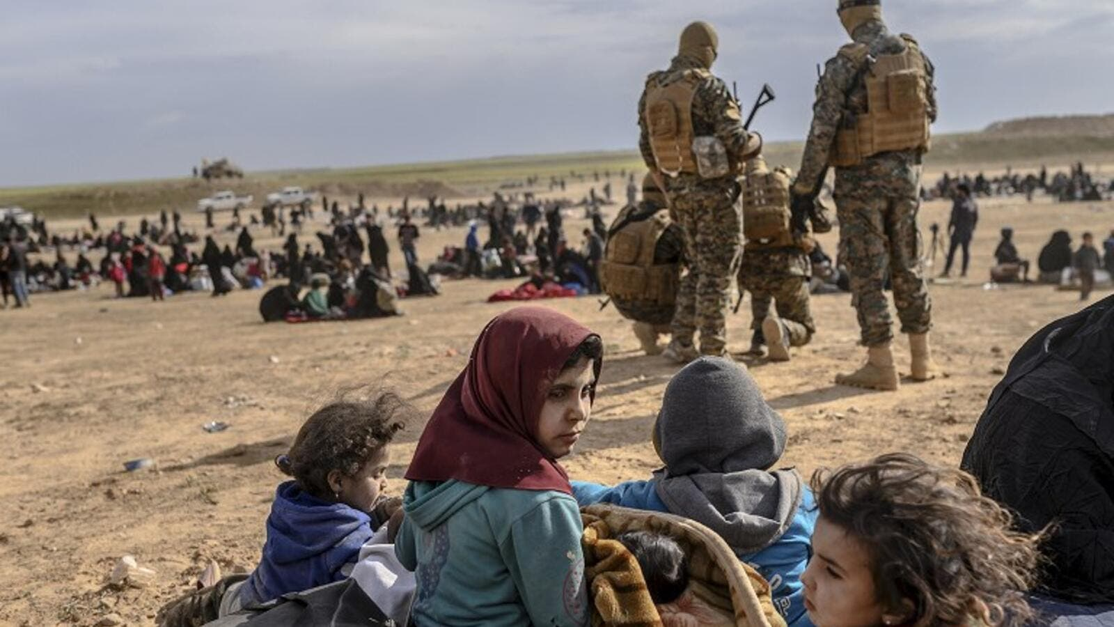 Civilians evacuated from the Islamic State (IS) group's embattled holdout of Baghouz, in the eastern Syrian province of Deir Ezzor. (Bulent KILIC / AFP)