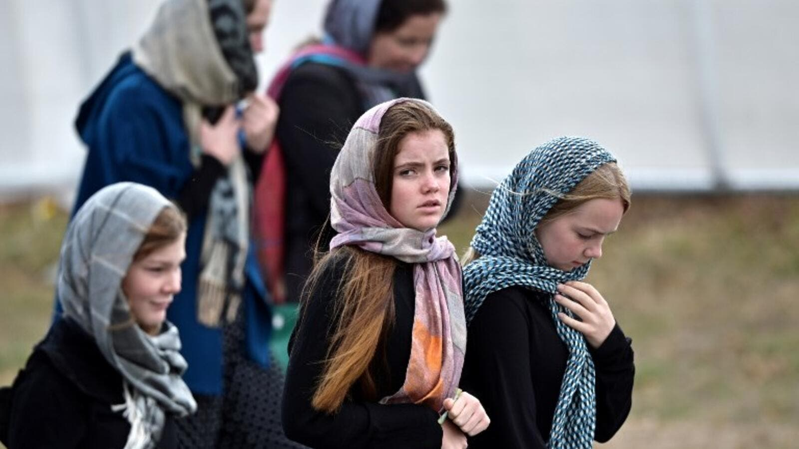 Residents and schoolchildren wearing headscarves arrive for the funeral of those killed in New Zealand's twin mosque attacks at Memorial Park cemetery in Christchurch on March 21, 2019. (AFP/ File)