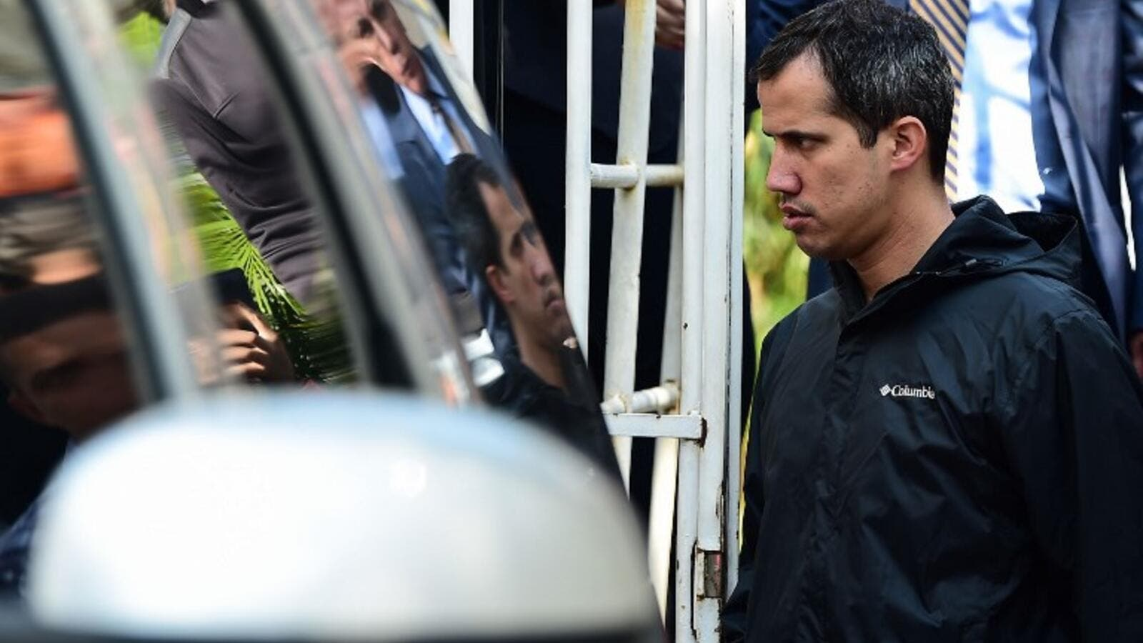 Venezuelan opposition leader and self-proclaimed interim president Juan Guaido leaves the residence of his Chief of Staff Roberto Marrero, who was arrested during a raid early March 21, 2019. (AFP)